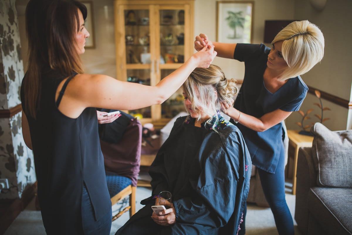 Bridesmain having hair done