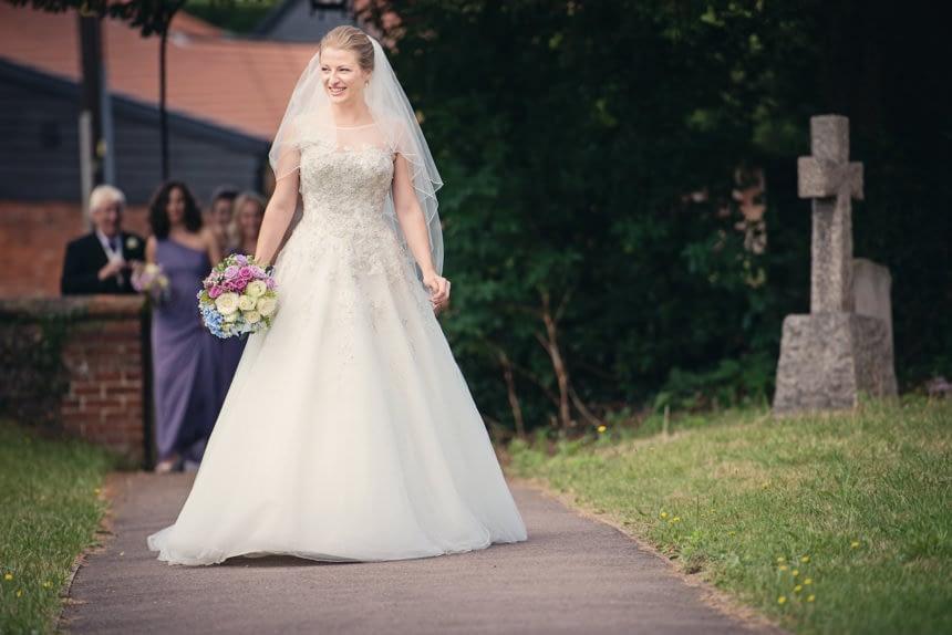 bride approaching church