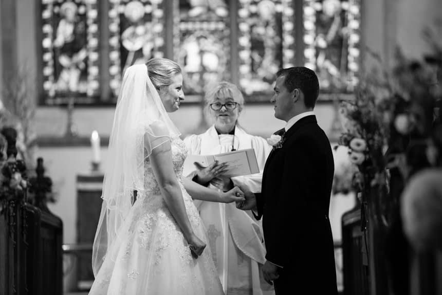 groom holding ring on brides hand