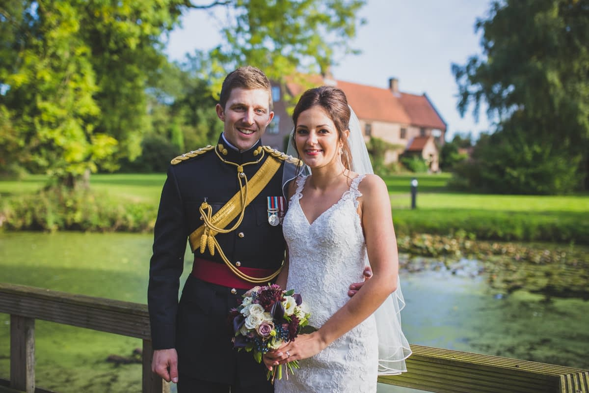 bride and groom in front of Ivy House Country Hotel
