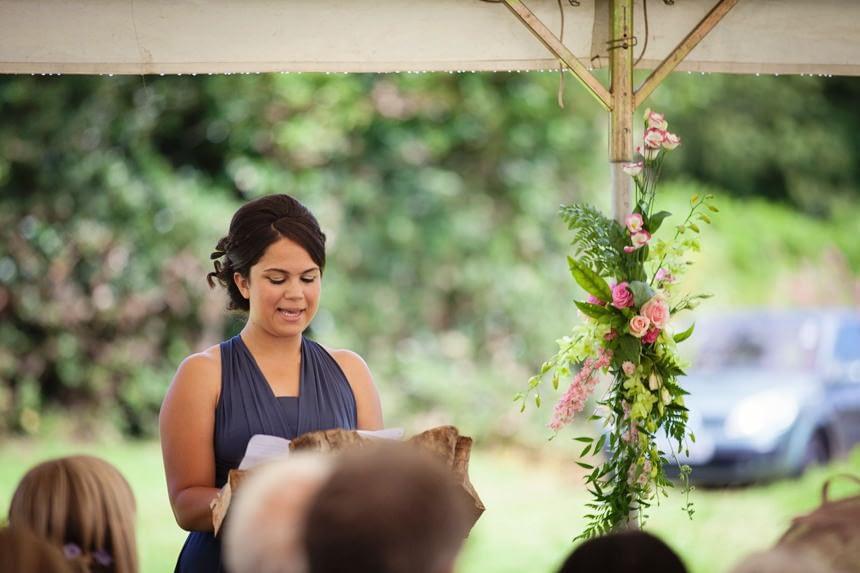 bridesmaid doing a reading