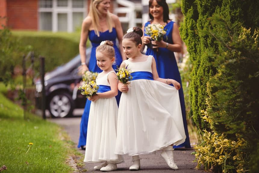 flower girls posing for a guest picture