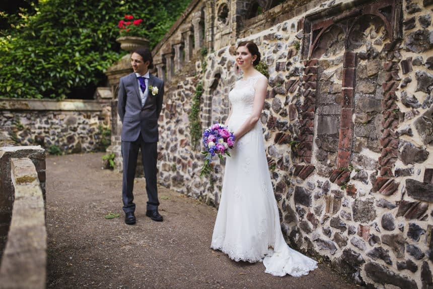 bride and groom standing apart