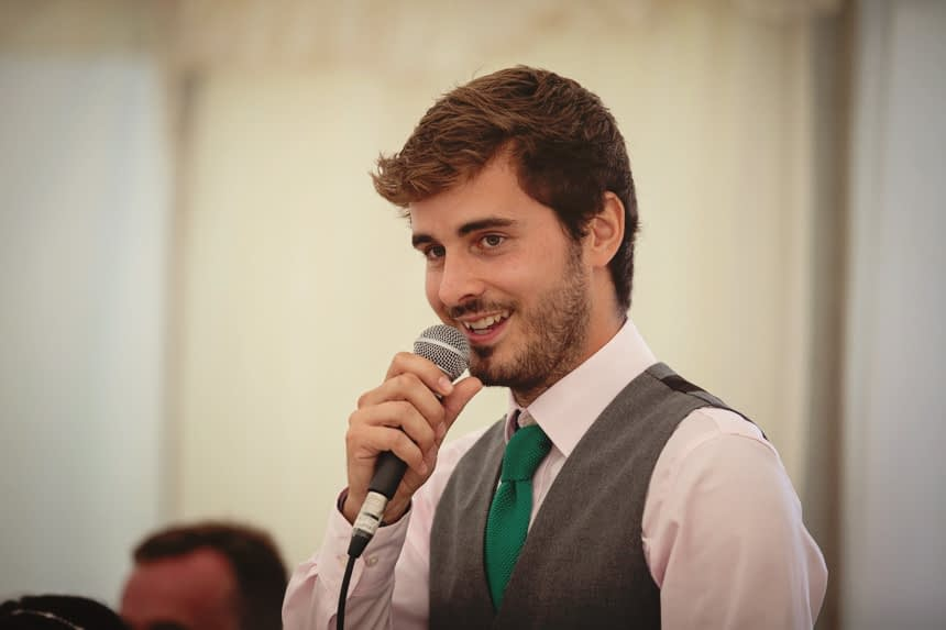 Groom with microphone