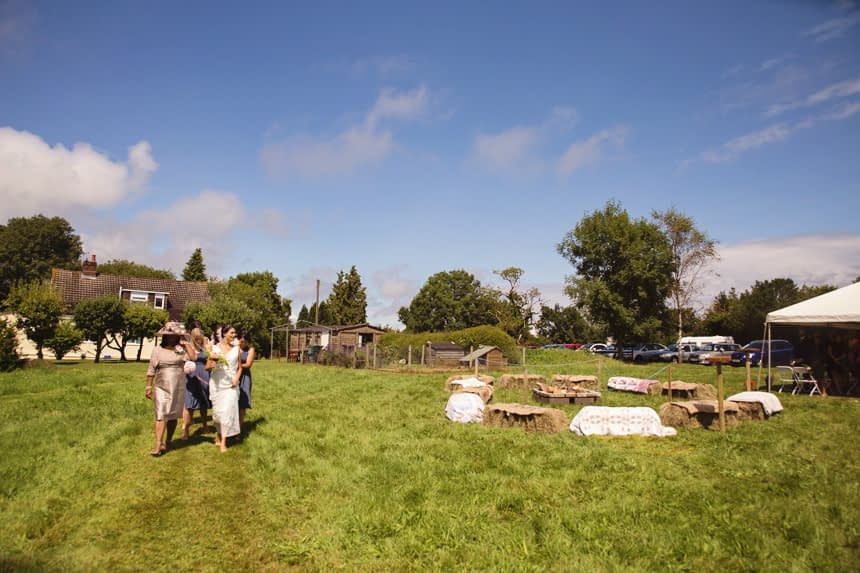 wide shot of bridal party walking to ceremony