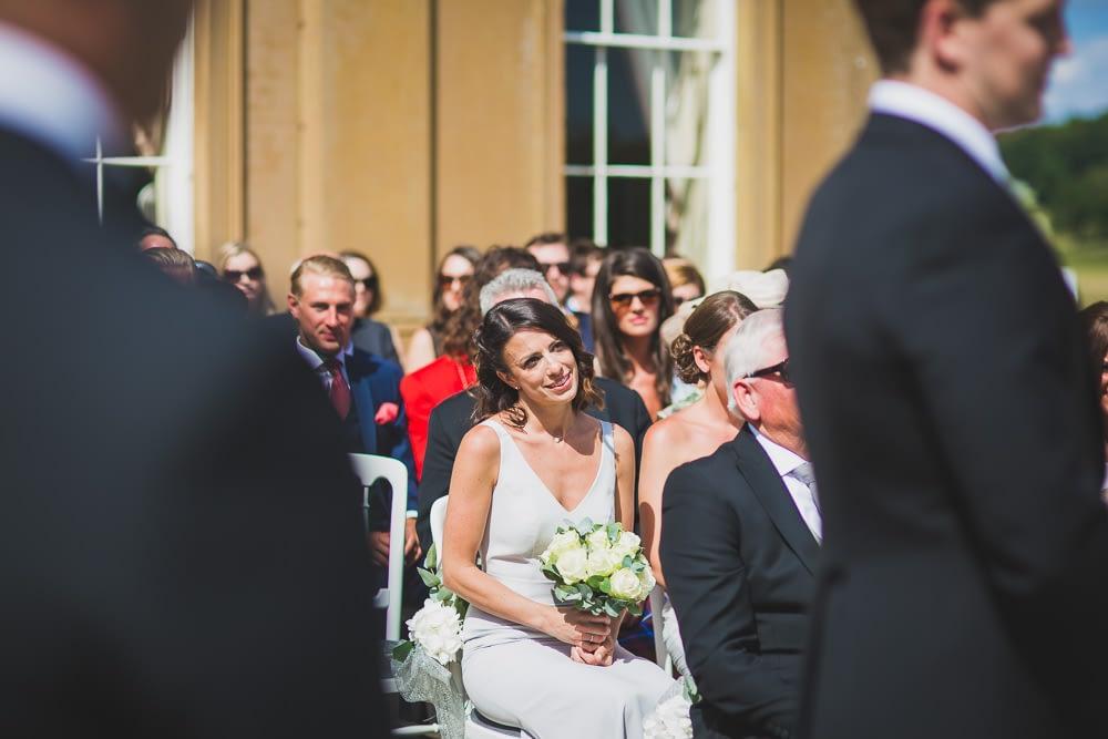 bridesmaid watching wedding
