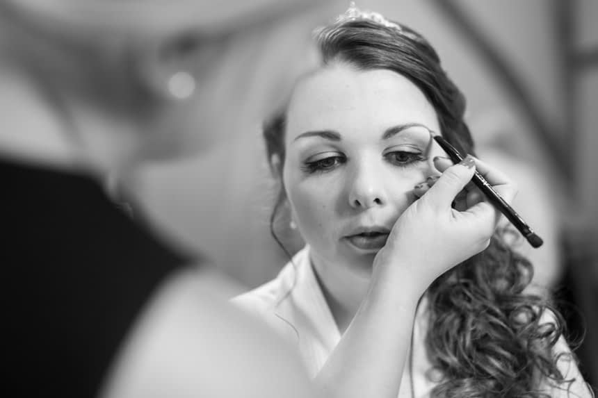 bride getting make up done