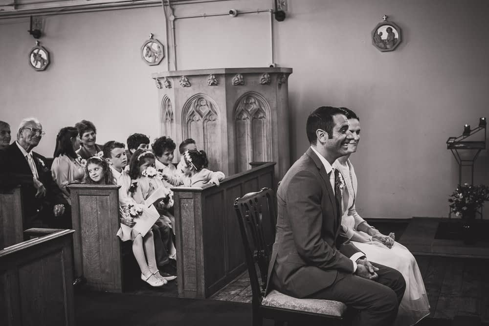couple sitting at front of church