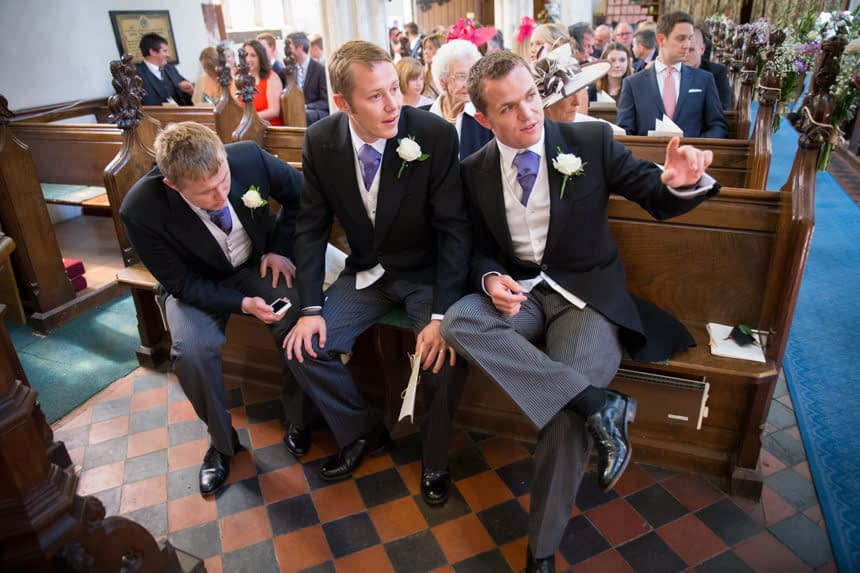 groom and best men at front of church