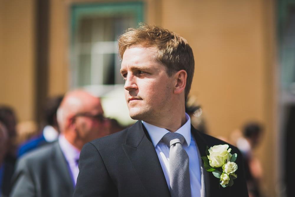 groom looking over shoulder