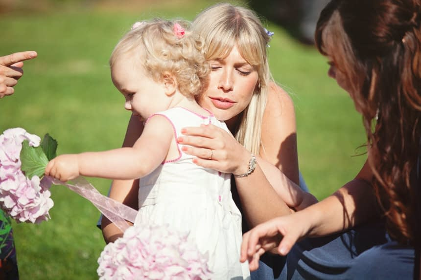 bridesmaid hugging young guest