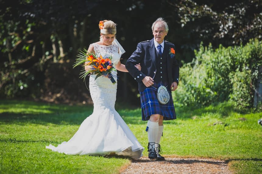 bride and father walking
