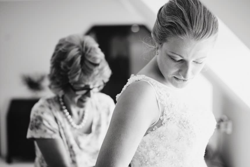 black and white bride looking down