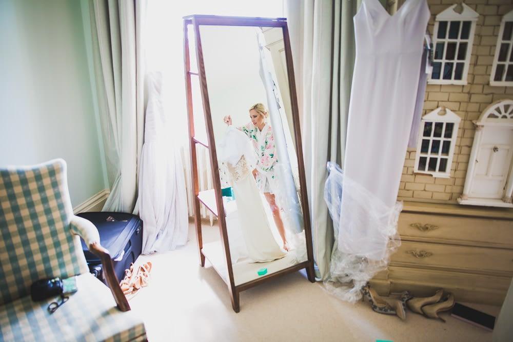 bride holding dress