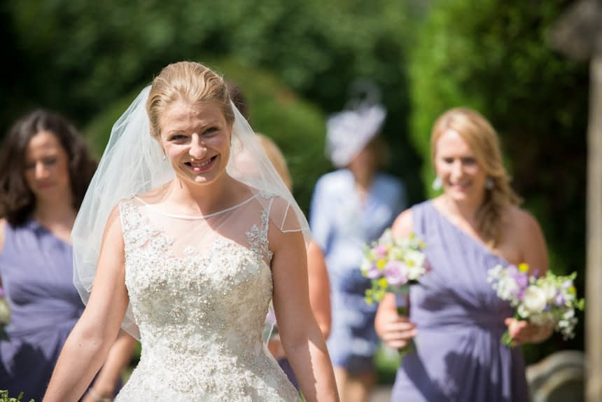 smiling bride outside church