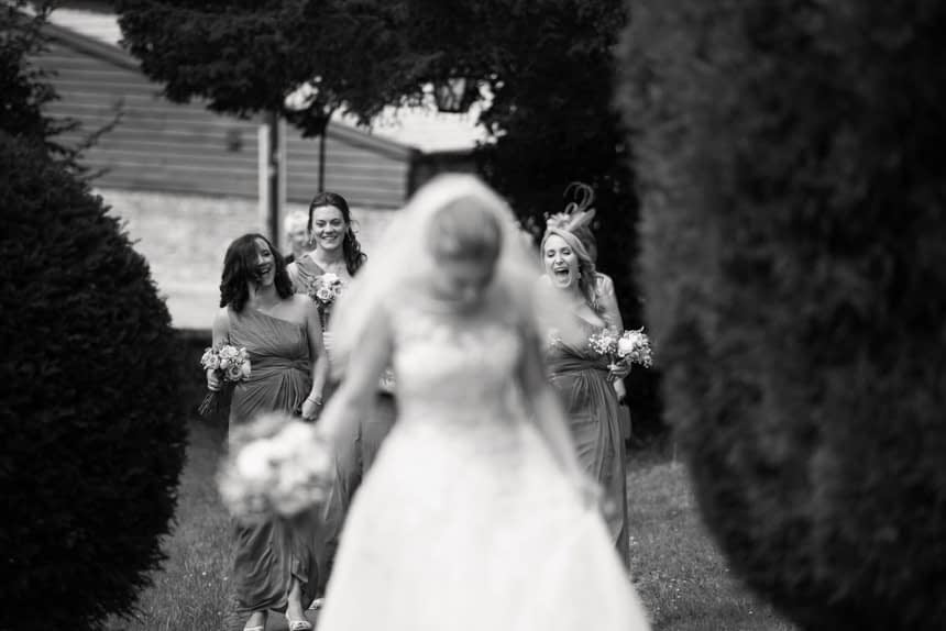 bride out of focus with bridesmaids in focus in the background