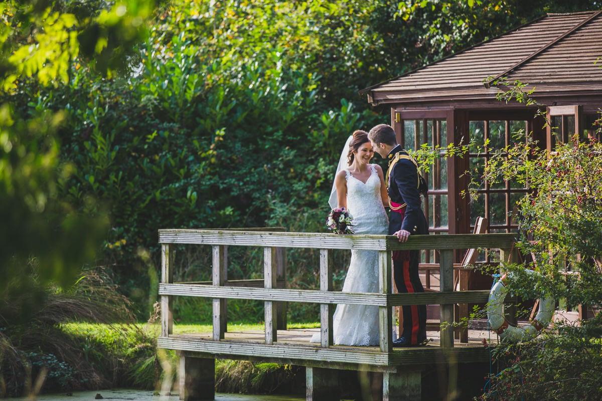 bride and groom on pontoon