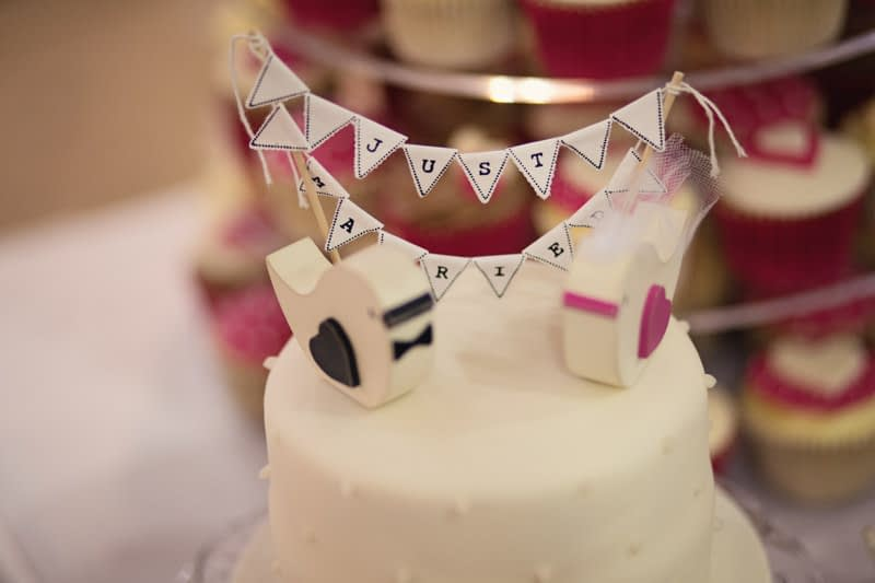 just married sign on top of cake