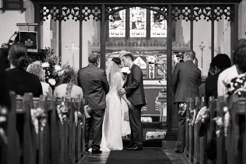 Bride and groom kiss for first time as man and wife