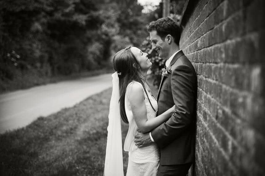 bride and groom hugging black and white