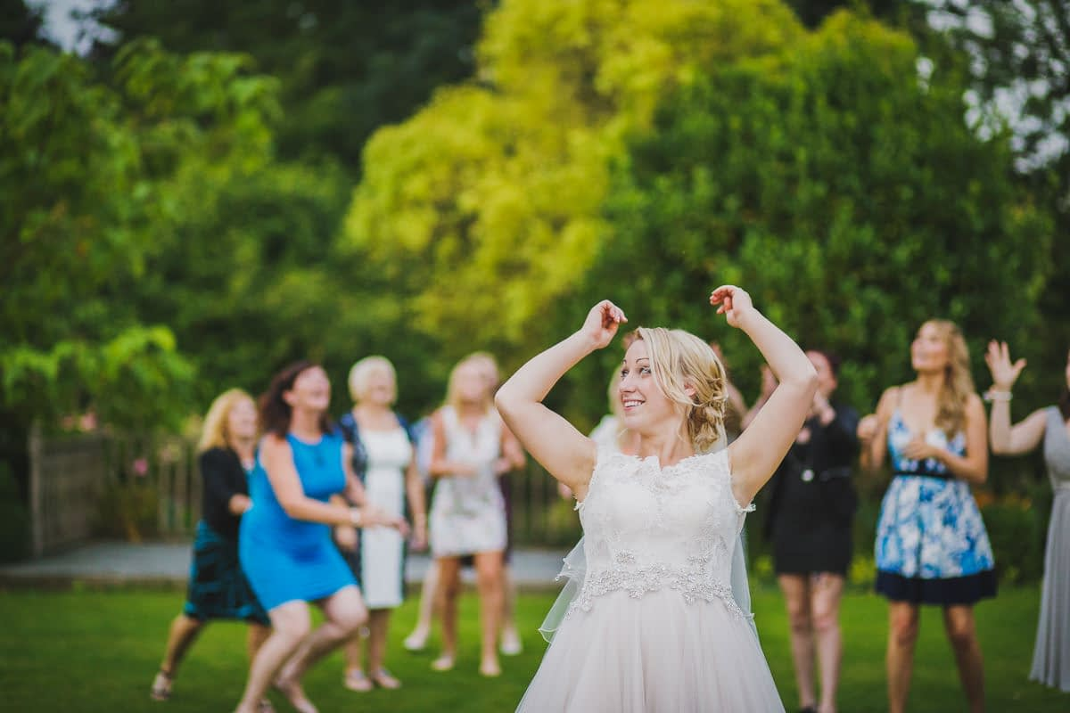 bride with arms in air