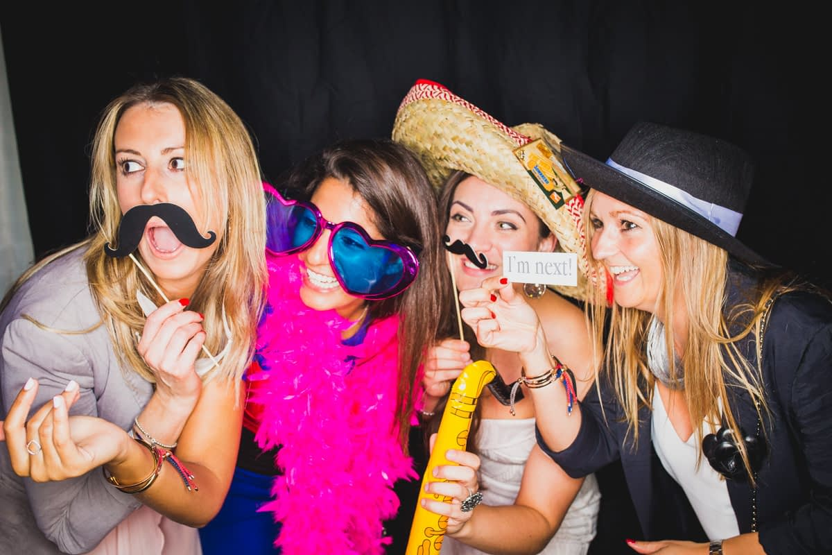 girls having a laugh in photo booth
