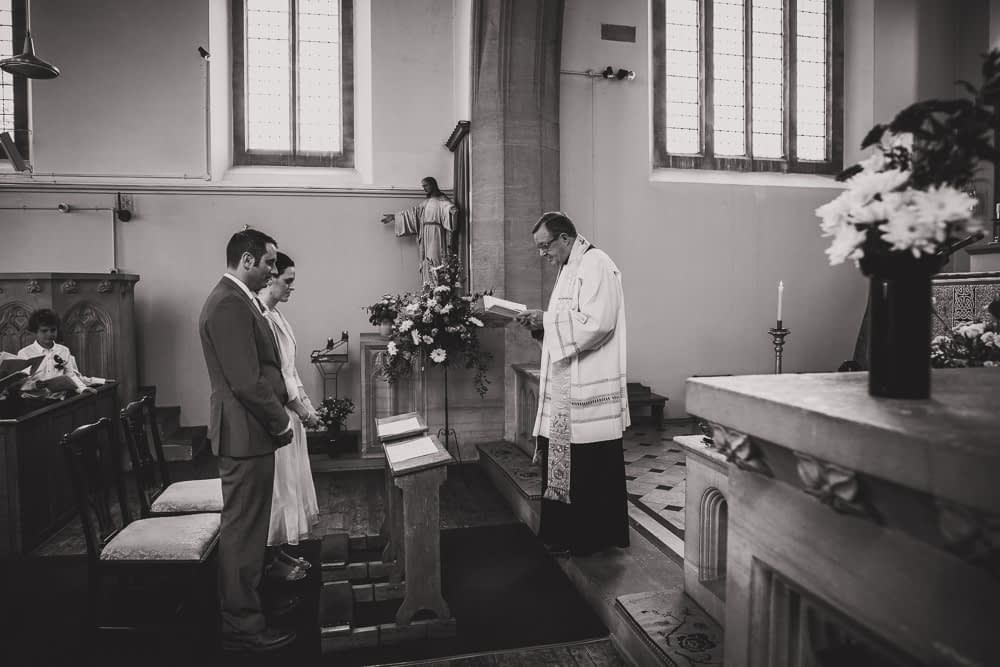 couple standing at front of church