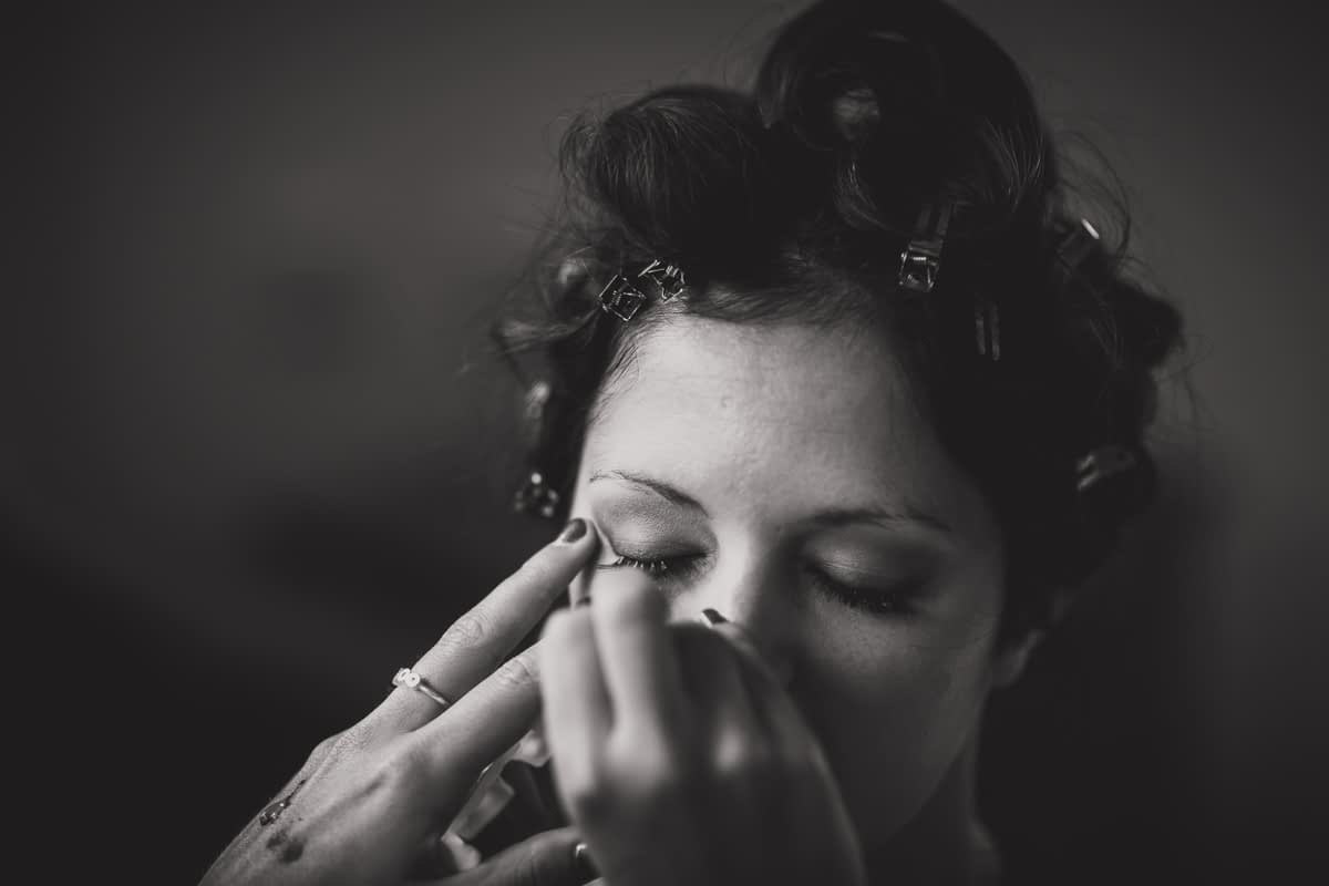 Eye liner being applied to bride