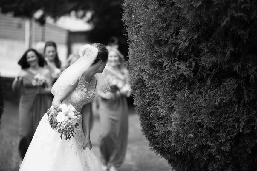 bride looking back at bridesmaids