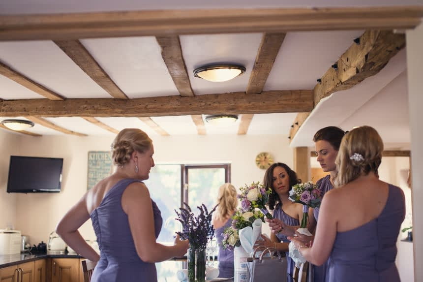 bridesmaids sorting bouquets