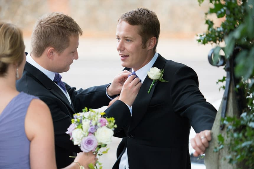 best men helping each other with ties