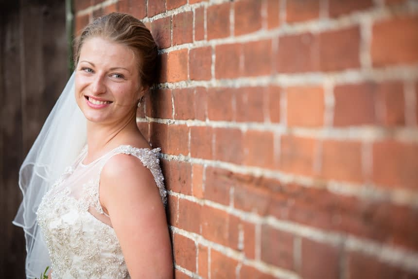 bride looking down wall