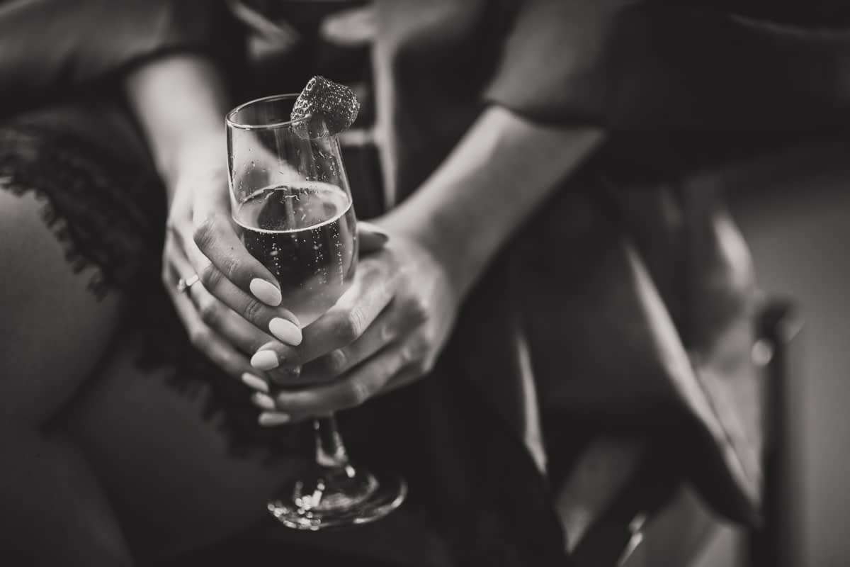 Bride holding glass of champagne