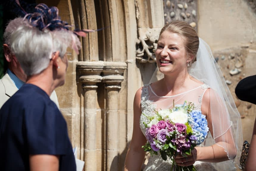 bride smiling at guest
