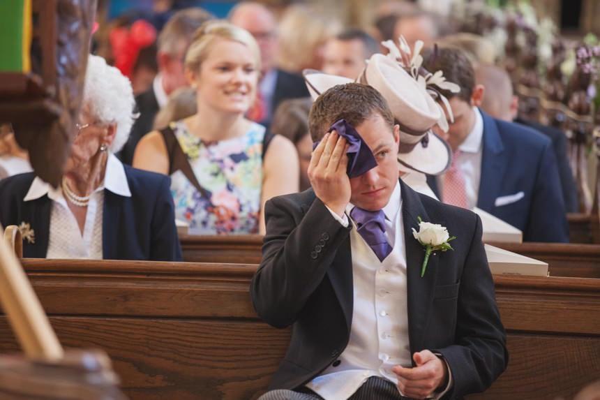 groom wiping forehead