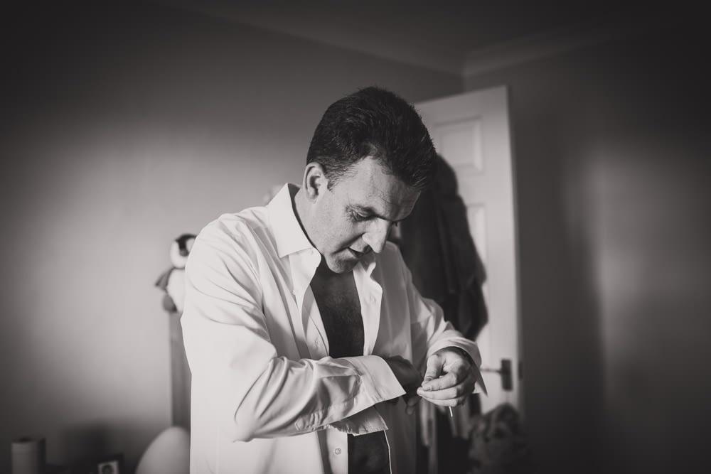 groom adjusting cufflink