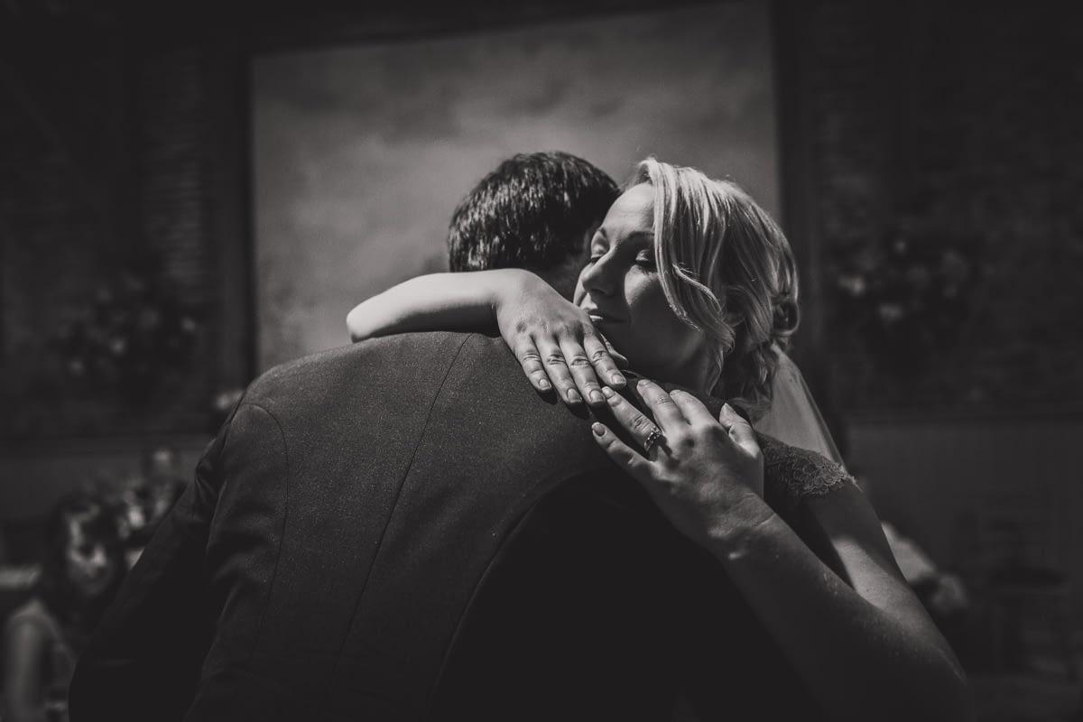 bride hugging best man