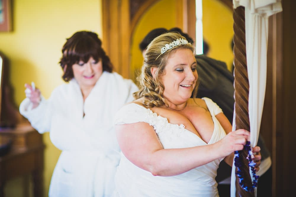 bride holding onto bed