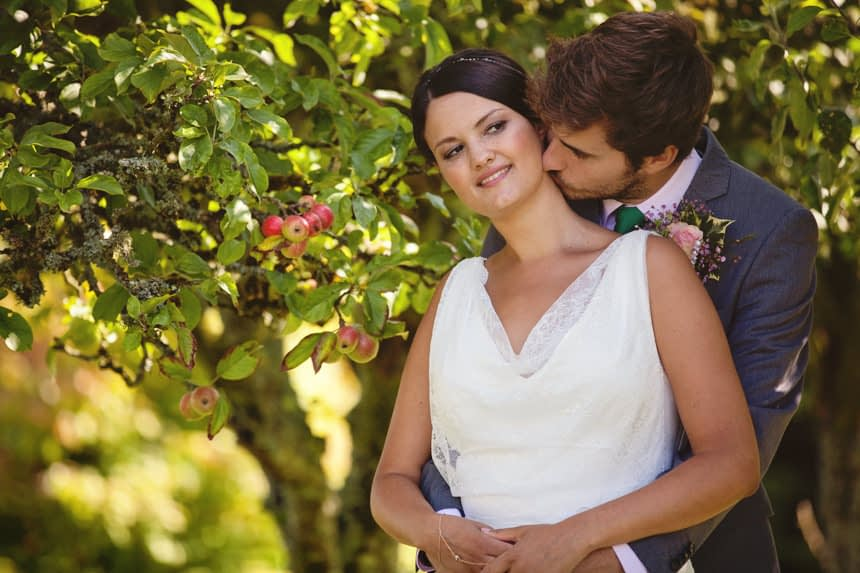 bride with groom behind her