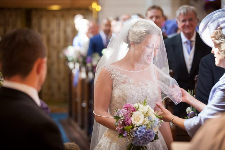 bride reaches front of church