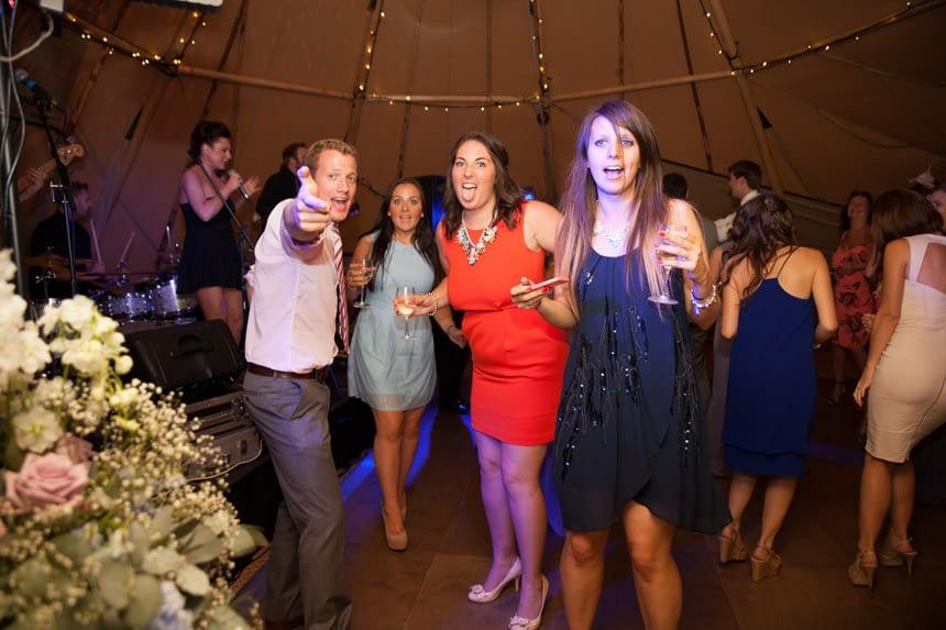 happy guests on dance floor