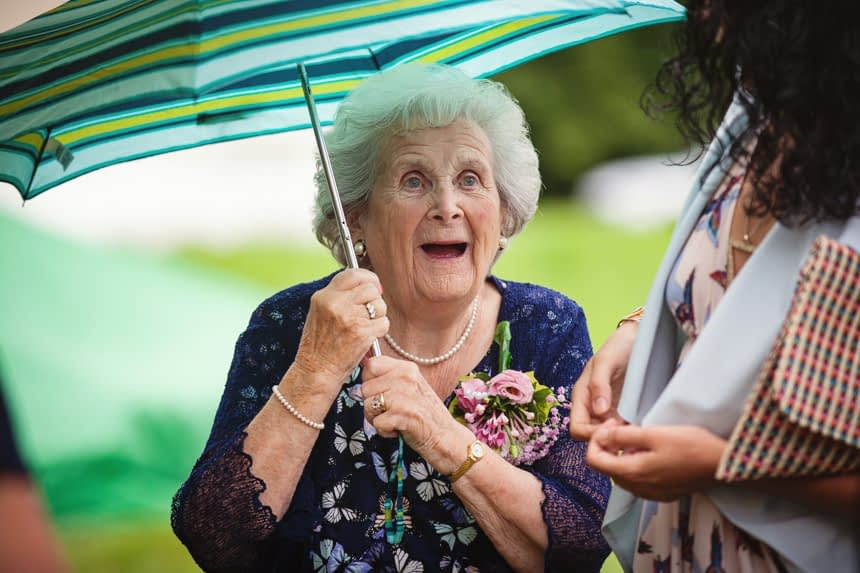 Grandmother holding umbrella