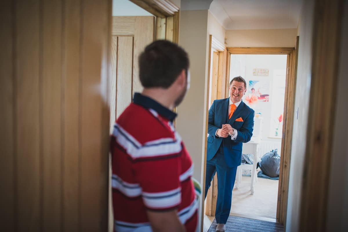 groom and brother in hall way