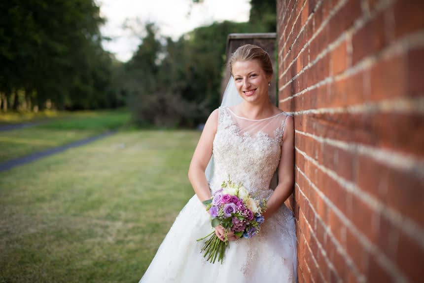 bride on her own next to wall