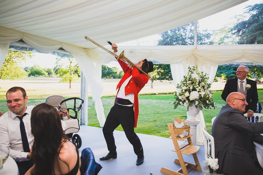 master of ceremonies playing trombone