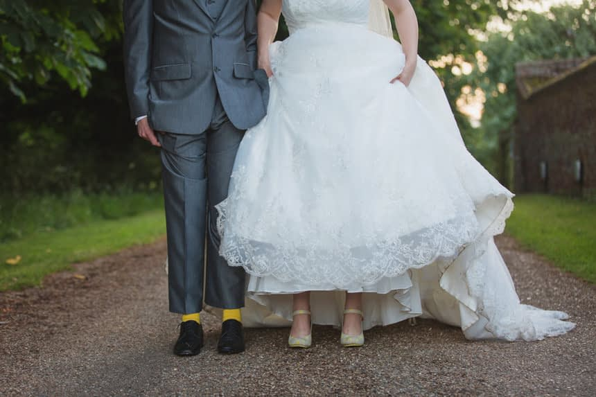 Bride and groom showing their feet