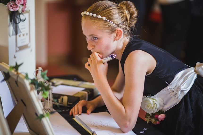 bridesmaid writing in guest book