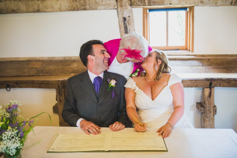 bride kissing mother of groom