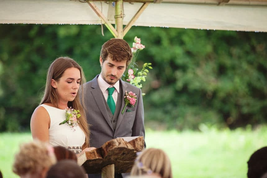 groom standing next to his sister doing a reading