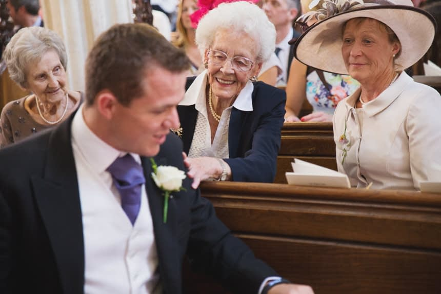 grooms mother and grandmother laughing with groom